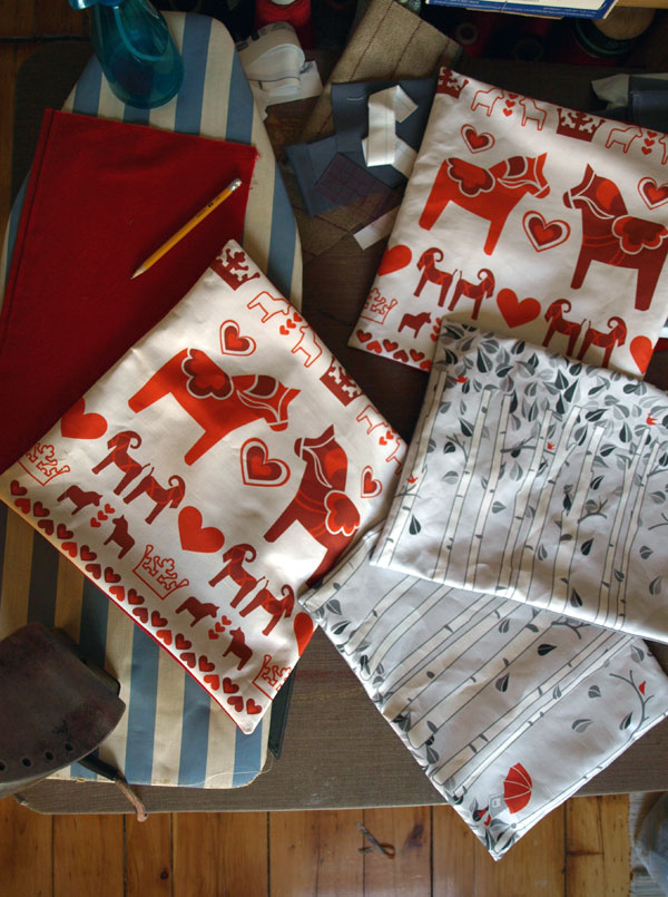 …And this is what I accomplished with my not-broken foot pedal: four more pillow covers. Trying a rectangular 'breakfast' pillow with the birch tree design… Enjoying dusk in the studio, and bare feet on the pine floor in this warm weather.
