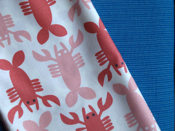 …And if I find time before the sale, maybe I'll make some little baby lobster bibs to sell! Just picked up some of this fabric. Too cute.