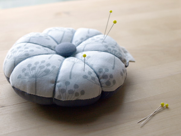 White and grey pincushion in this darling fabric from Lotta Jansdotter.
