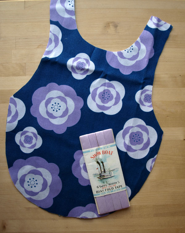 And my last splurge of the day, post-cutting (actually… I think there was one more), this darling purple floral for a little girl's smock, in the works.