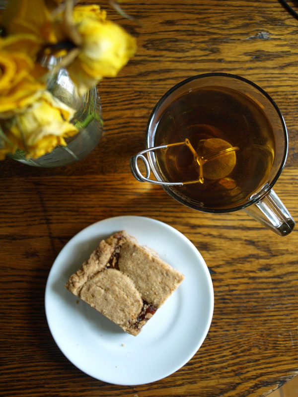 Daily 'Bread': Not quite bread, but home from the bakery and delicious just the same…. and not too shabby, starting off the day with a raspberry linzer bar, and a nice cup of tea.