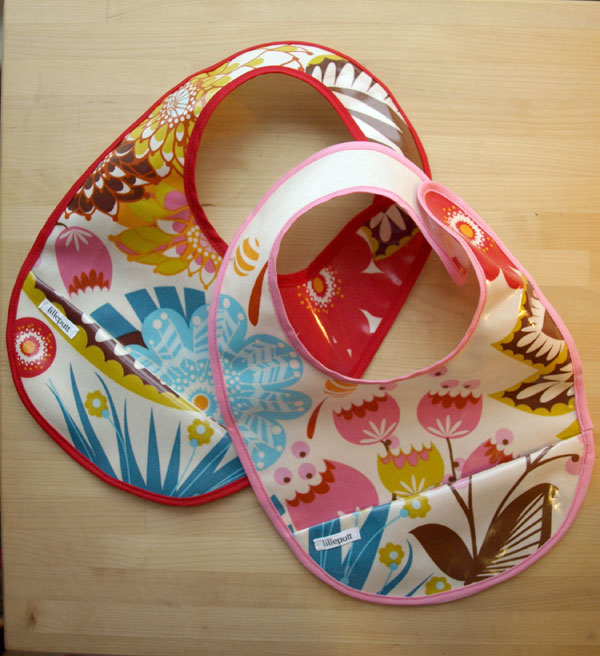 "New laminated cotton bibs with Anna Marie Horner's ""Summer Totem"" fabric… in the shop soon!"