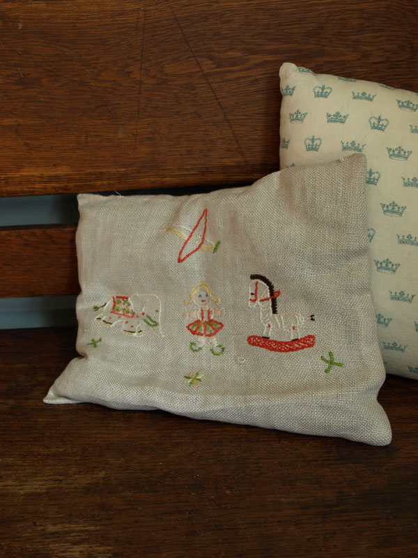 I love this little pillow; one my mom embroidered sometime in her childhood.