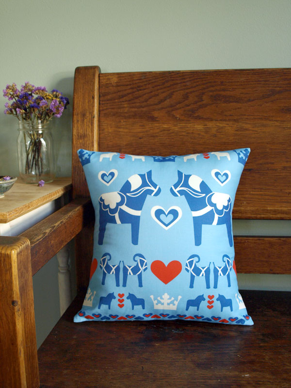 Dalahäst pillow now in the blue color way as well…  and in the shop soon!