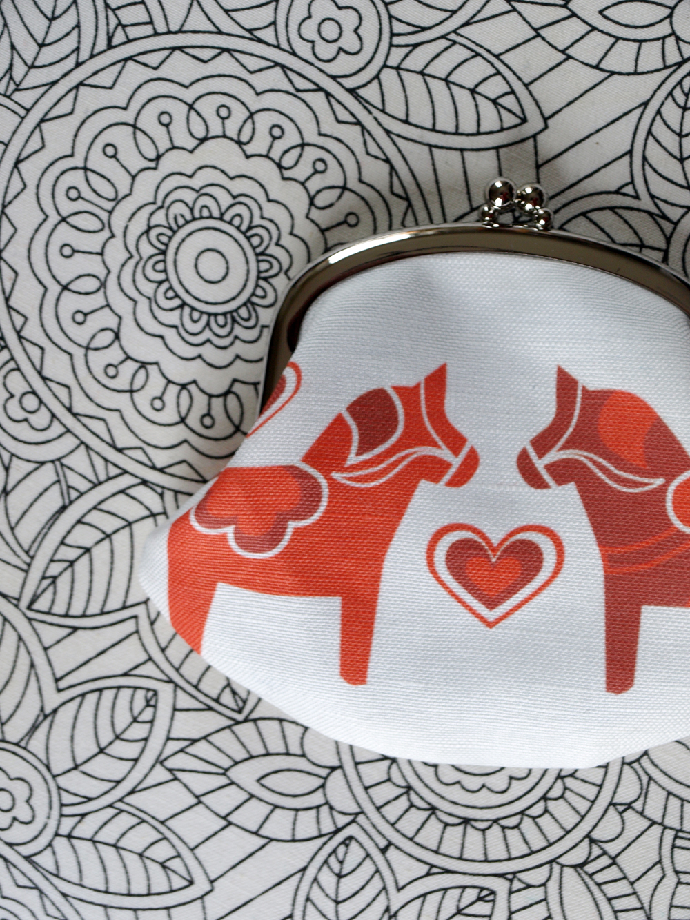 The popular red dala horse design… now as a coin purse too!    And up next: little sheep purse anyone?