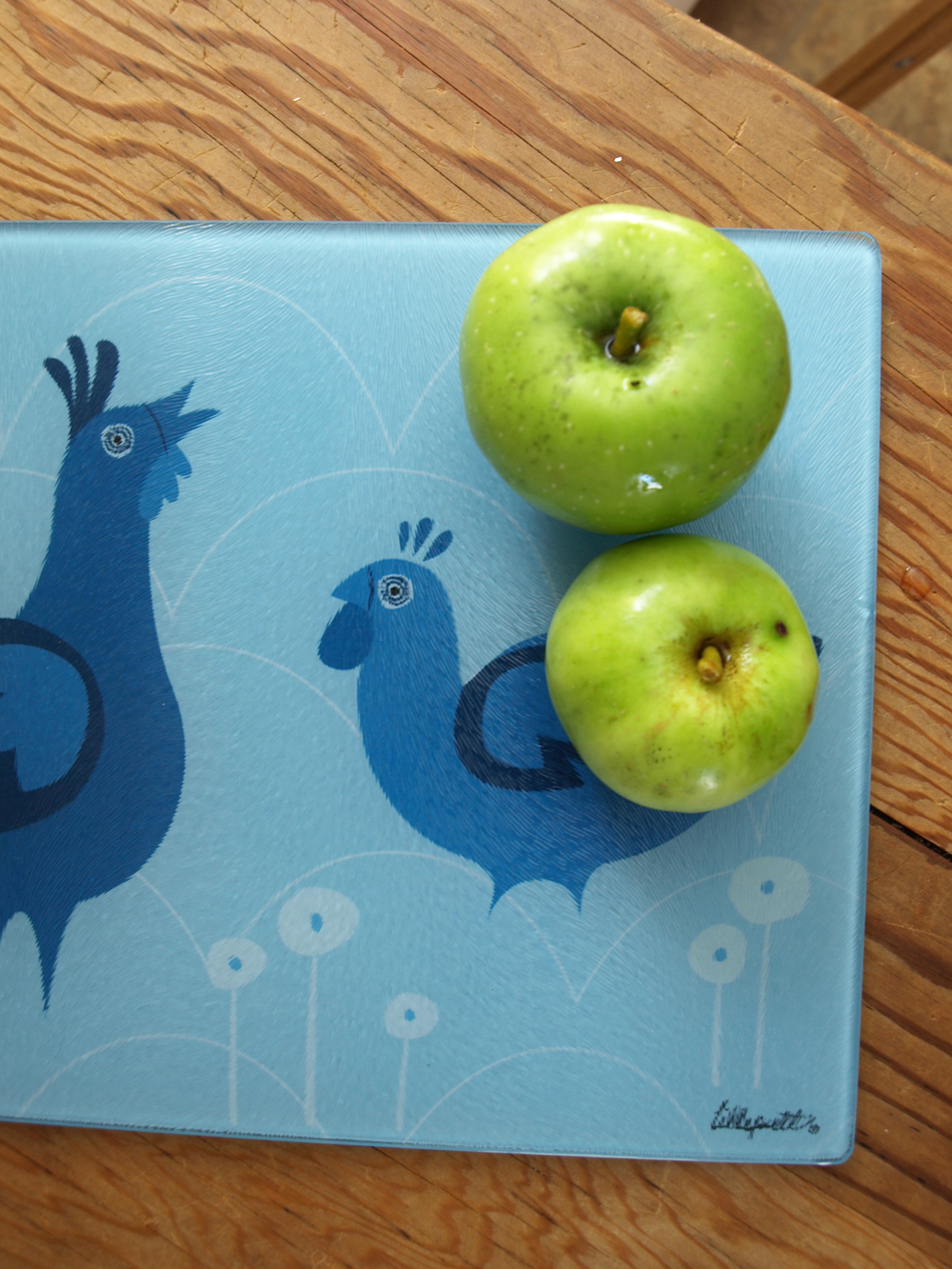 Tart little apples anyone? How about a blue rooster and hen cutting board?     Adding some glass cutting board/cheeseboard of the new designs… Up next, an old favorite, our birch tree print!