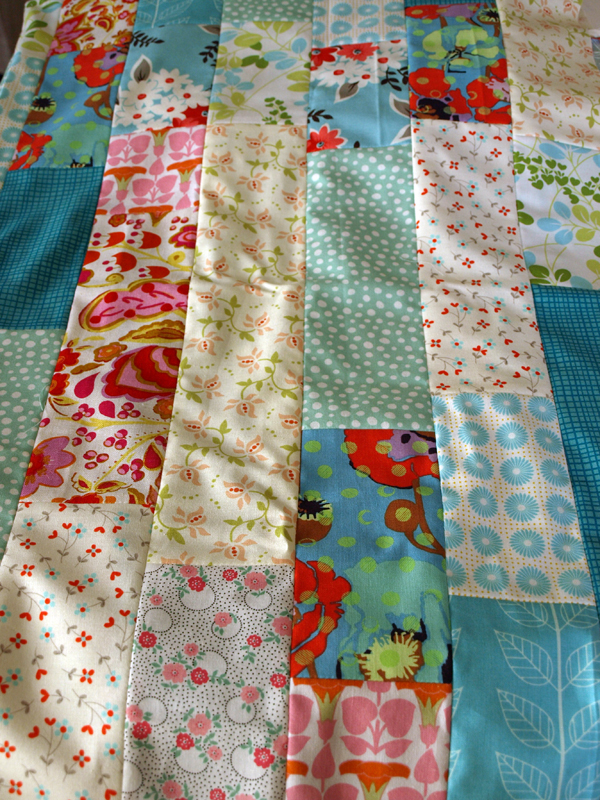 I decided it was time to tackle my collecting habits and try to use up some of the fabric lying around here to make us a quilt. Unfortunately, there were SO MANY cute new fabrics at the local shop… I couldn't resist.