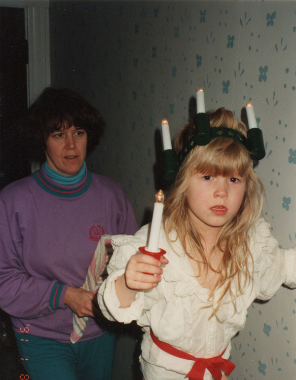 Dug up this photo at my mom's and had to share: My mom and me a couple Lucias past.    There wasn't much singing this Lucia, apparently I wailed the whole time (if you can't see the tears on my cheeks). Needless to say, we didn't try that again!    (Photo is cropped for decency, as I didn't have a skirt to match the blouse).