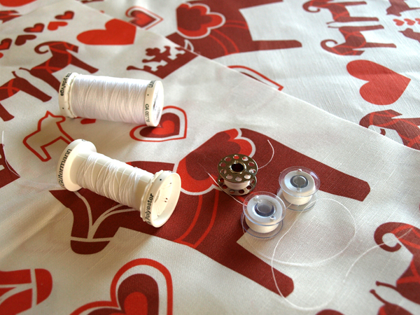 In the midst of a sewing marathon!   Unfortunately, my bobbin winder is on the fritz again (even with the top of my machine removed! As tedious as that was…) so I carry bobbins on me and borrow other people's bobbin winders when I can. Luckily I am fully wound for the time being.