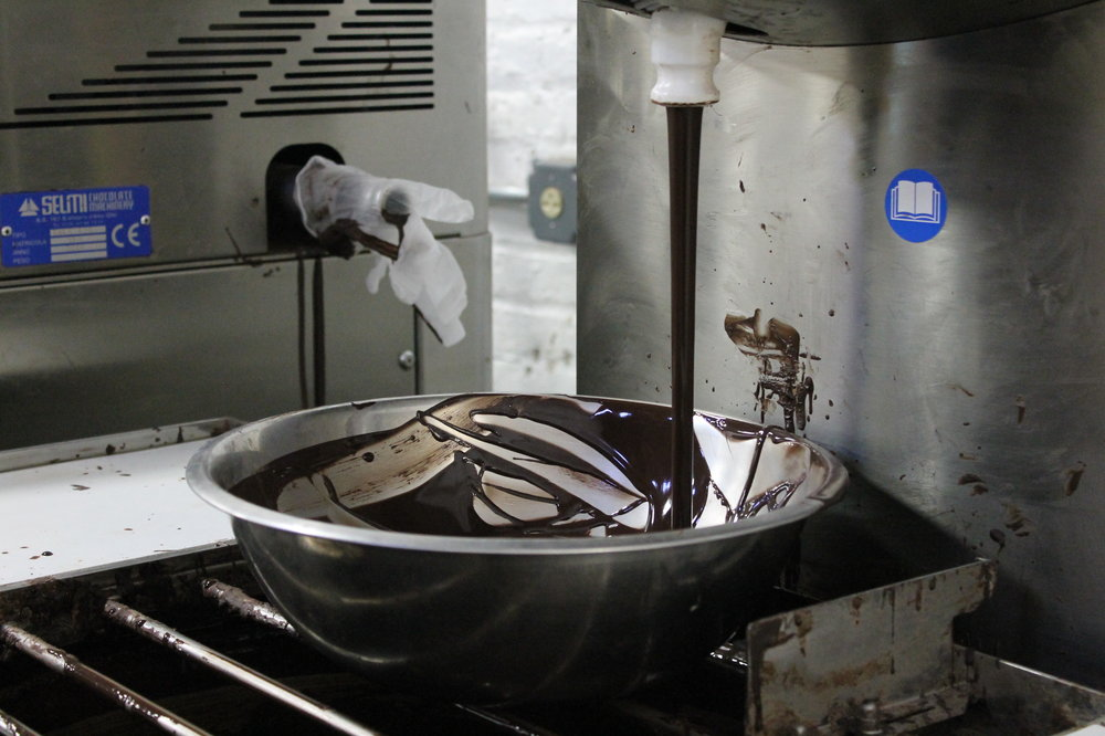 After the chocolate is ground, it's put into this machine to wait to be processed into bars.