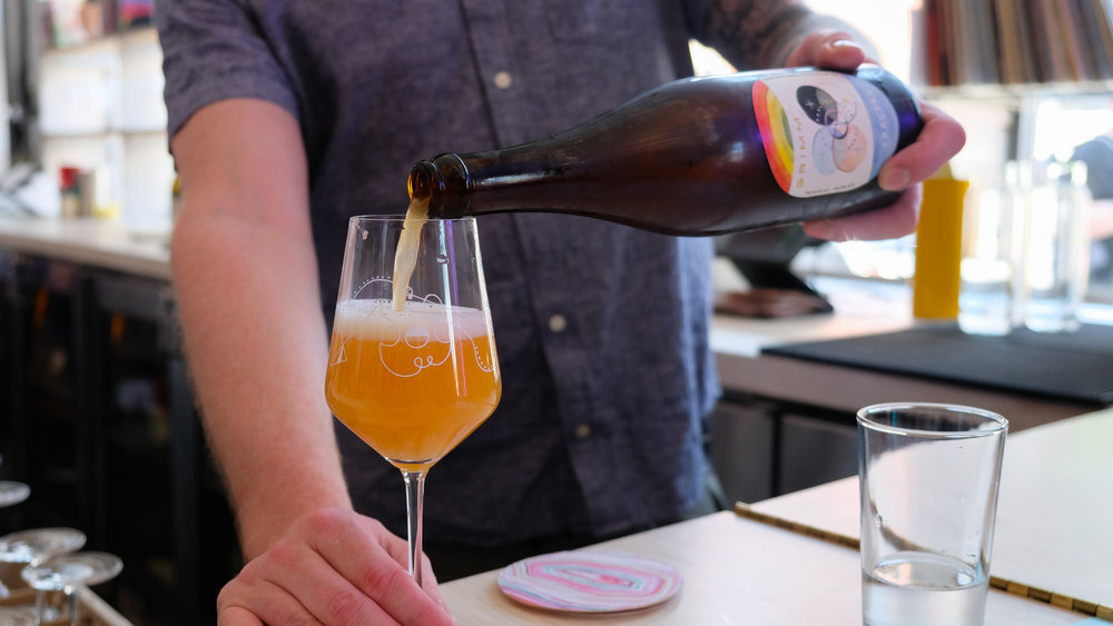 Grimm's Tracery is a Saison de Coupage, a traditional Belgian farmhouse style in which barrel-aged sour beer is blended with fresh saison.