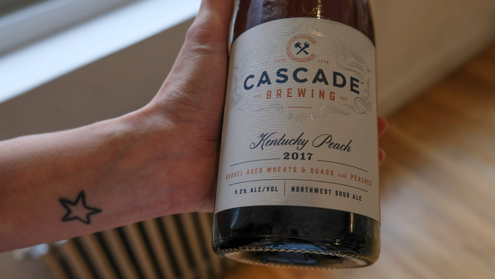 Cascade's Kentucky Peach is a blend of sour wheat and quad ales aged in bourbon and wine barrels for up to 16 months with more than 7,000 pounds of fresh Northwest-grown peaches.