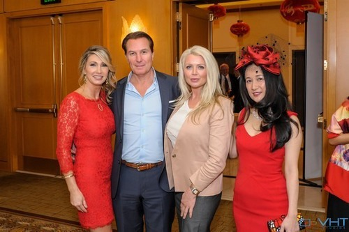 PICTURED ABOVE: Ladies in red, RSIR owner Stacy Jones (left) and couture fashion designer Luly Yang (right) flank RSIR broker Candace Taylor and her guest.