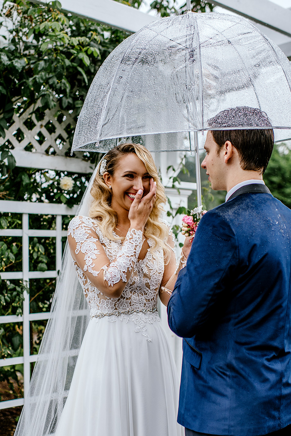 tearful bride during ceremony in the rain