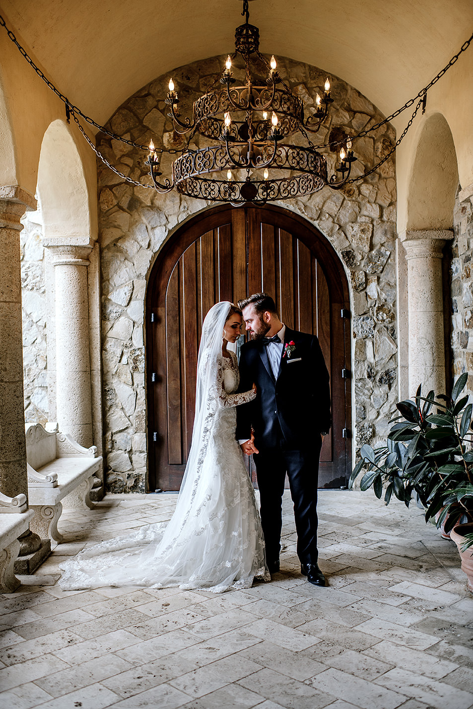Bride and Groom standing in a beautiful hallway at Bella Collina Florida