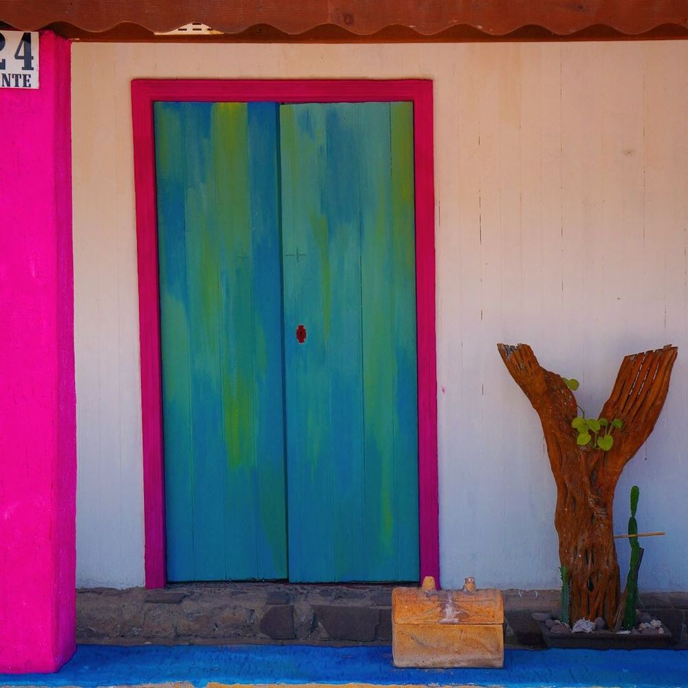 pink and blue doors of loreto