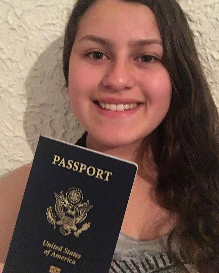 Deija showing off her new passport thanks to The Passport Party Project!