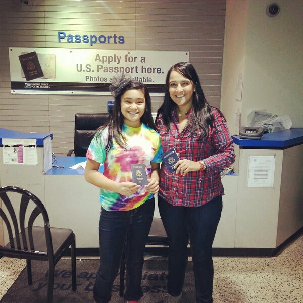 Soleil and I holding our passports as we celebrated National Passport Day!  (phase 1 of The Passport Party Project)