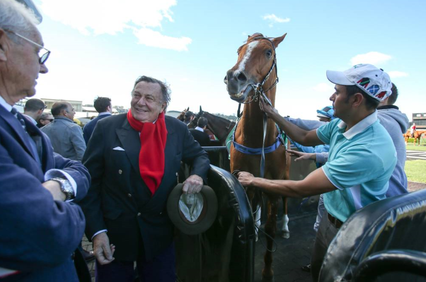 Entertainer Barry Humphries celebrated his first winner when Dante Rossetti saluted at Kembla Grange. Picture: ADAM McLEAN