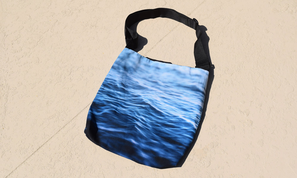 dark waters tote on pool deck resized 2500x1500.jpg