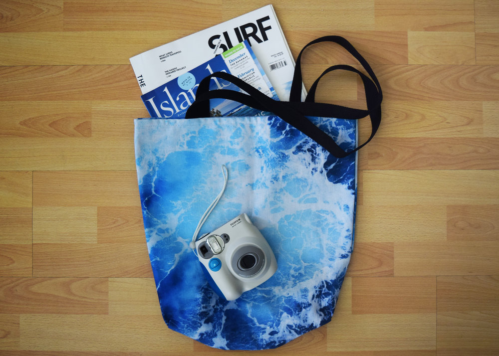 blue ocean surf tote on floor with magazines and instax camera.jpg