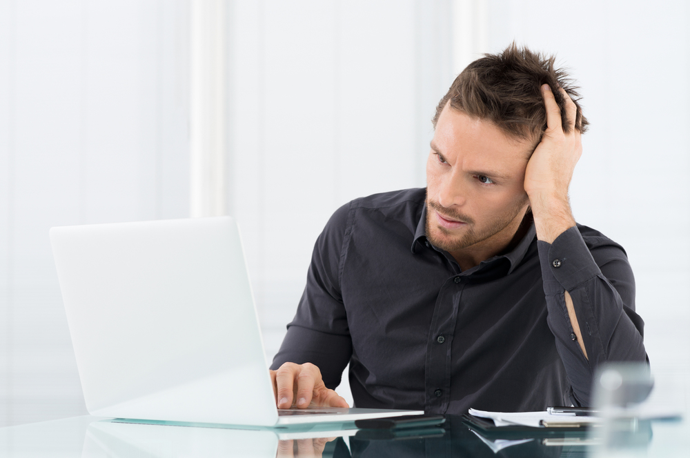 bigstock-Stressed-Man-Working-On-Laptop-47748787.jpg