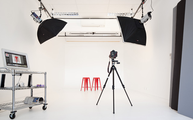 pod studios: main cyc wall studio space with overhead lighting system and production trolley with hifi.