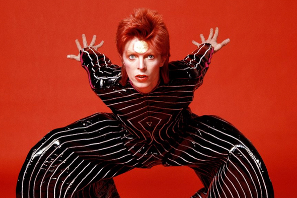 David Bowie photographed by  Mick Rock wearing  Kaisik Wong .