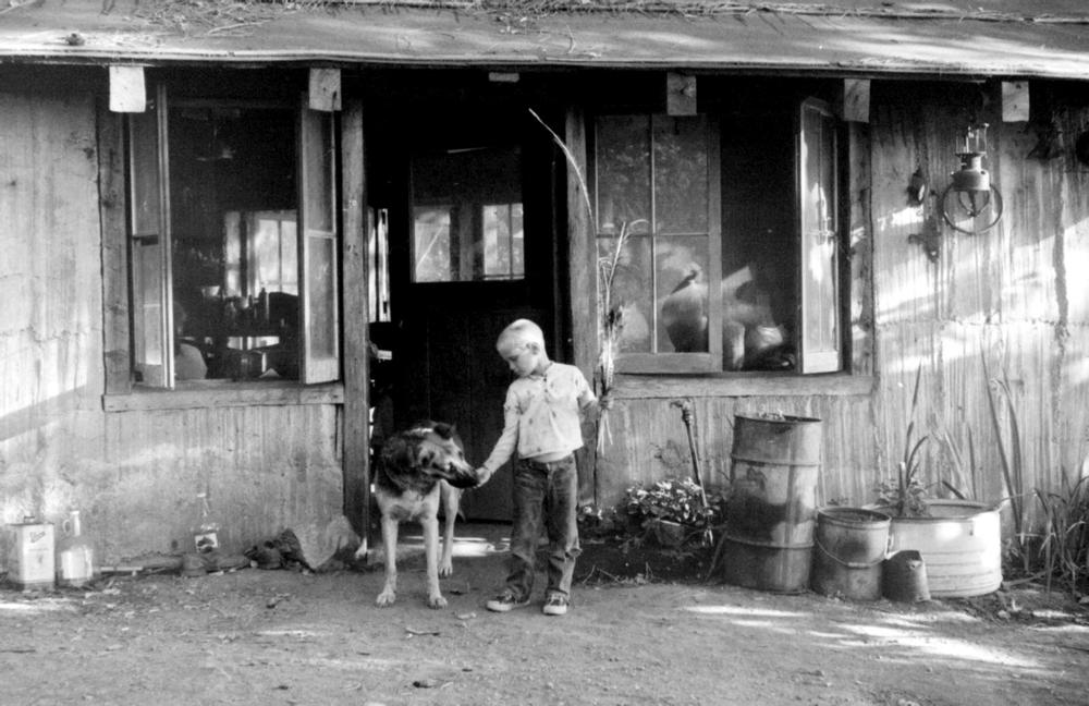 A friend of Henry's son in front of the Big Sur cabin.