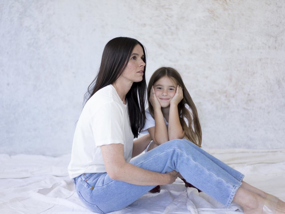 Heather Moeck(with daughter, Isla) wearing Collector Fit in Medium Wash and Sunday tee in Vintage White.