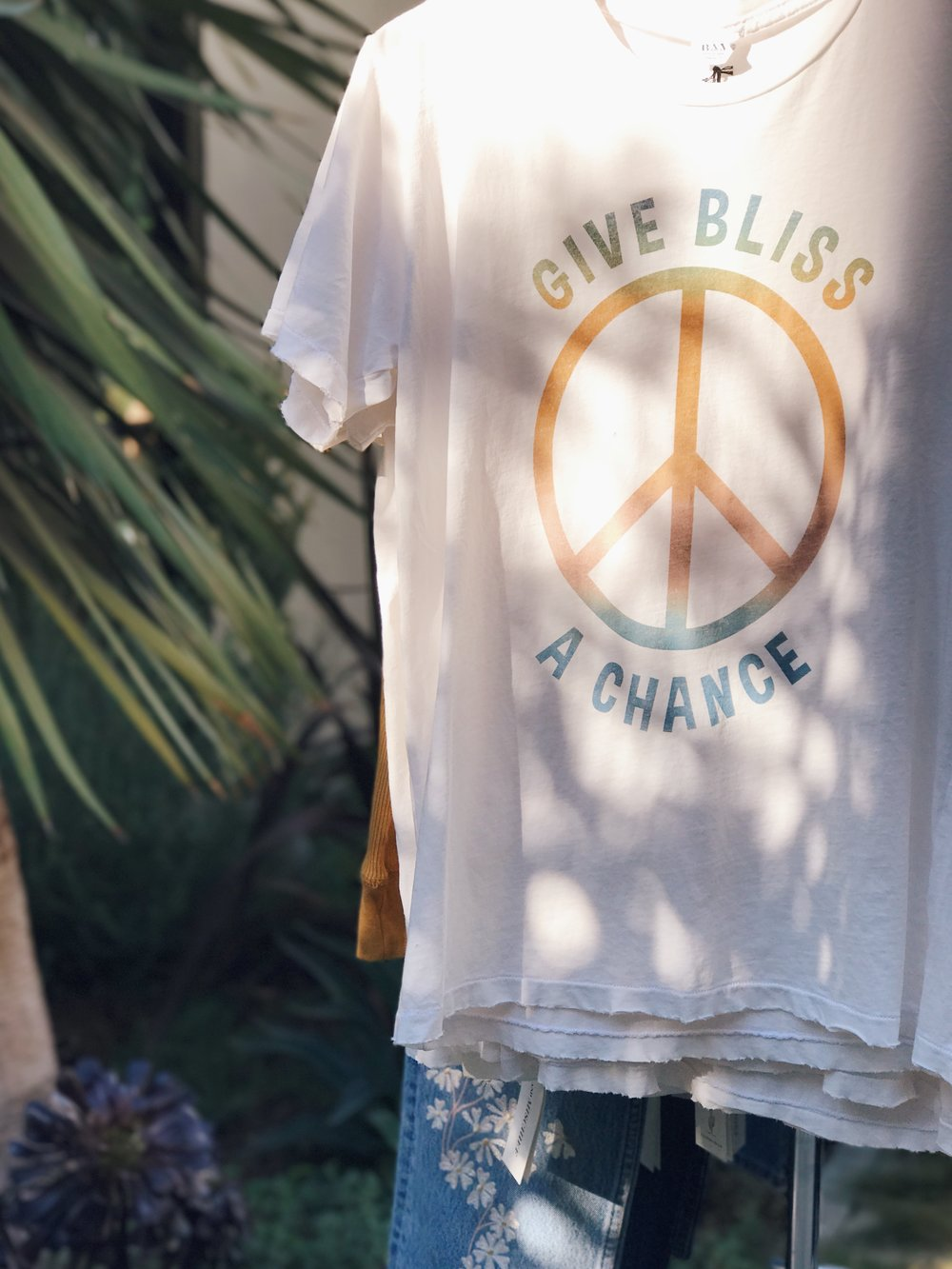 "Our First Love. - ""Bliss And Mischief is often known for our denim, but for me, t-shirts are my first love. Just ask the 3 stacks of white tees on my dresser right now.""-Hillary, Designer/Founder"