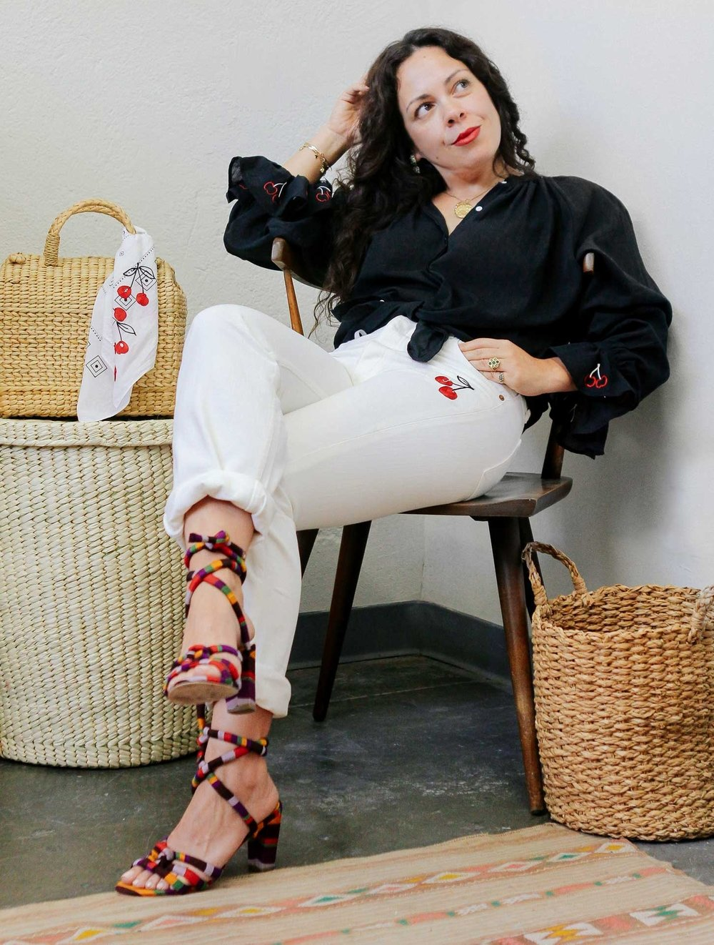 Joanna wearing our Cherry Peasant Blouse in Black
