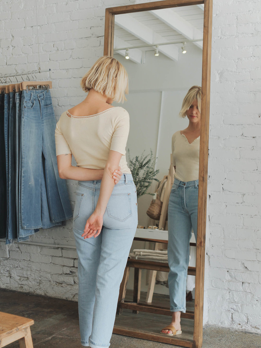 Candace wearing her Collector Fit denim in Light Wash