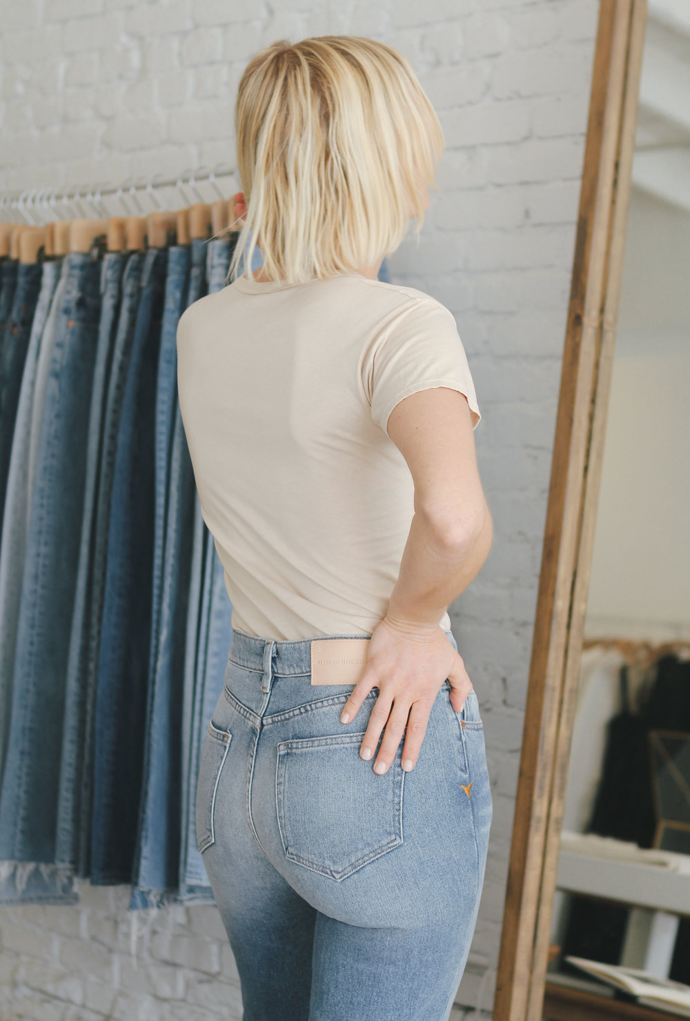 Candace wearing her Collector Fit denim in Mediium Wash