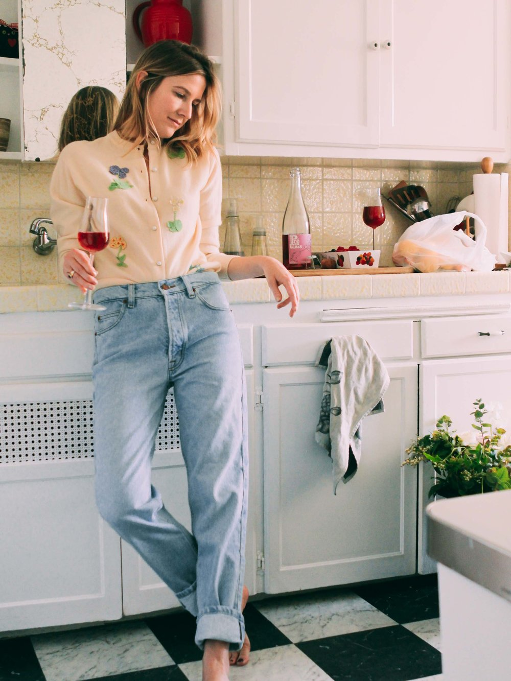 Katherine wearing a  vintage Floral Applique Cashmere sweater  in her Silver Lake home.
