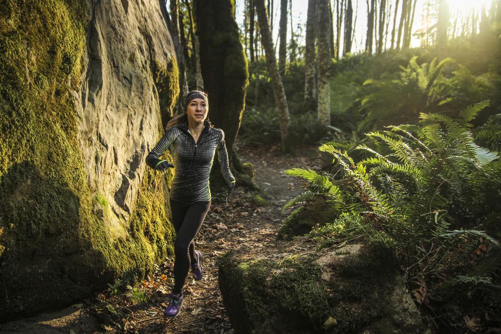 Portrait of triathlete, Abbi Milner, on the Larrabee Rock Trail, Bellingham, WA.