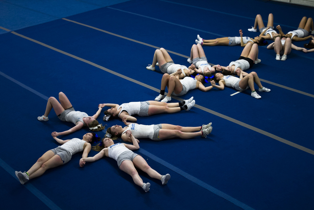 Members of Northwest Cheer's advanced SilverStars team hold hands and visualize their performance before practicing on January 28, 2015 at the Northwest Cheer Gym.The SilverStars are made up of multiple competitive all-star cheerleading teams ranging in ages 5-18 years old.