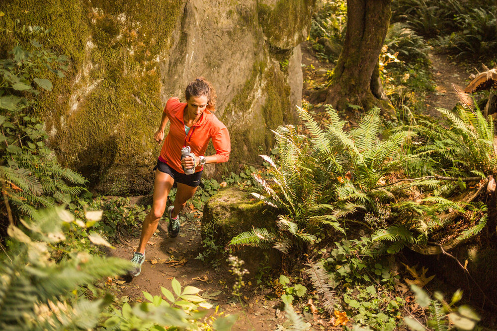 Prolific ultrarunner, Krissy Moehl running through her local trails in the Chuckanut Mountains, Bellingham, Washington.