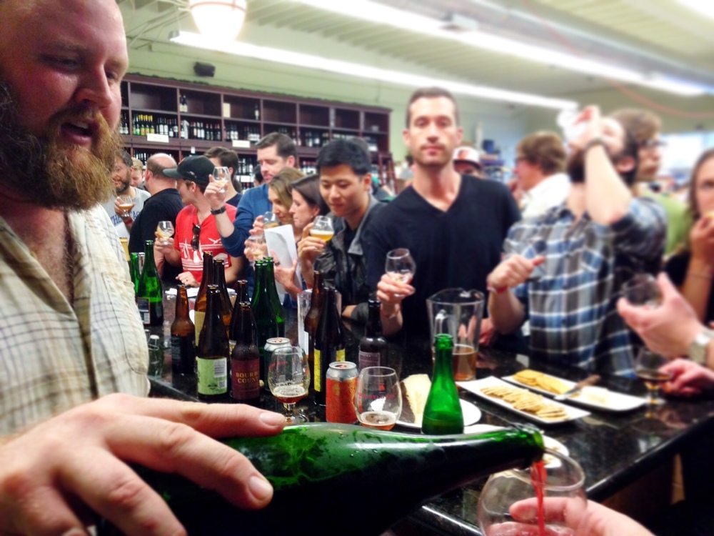 "Eric Cripe pours some De Ranke Kriek for a lucky taster at the ""Eric's Last Call"" tasting at The Jug Shop"