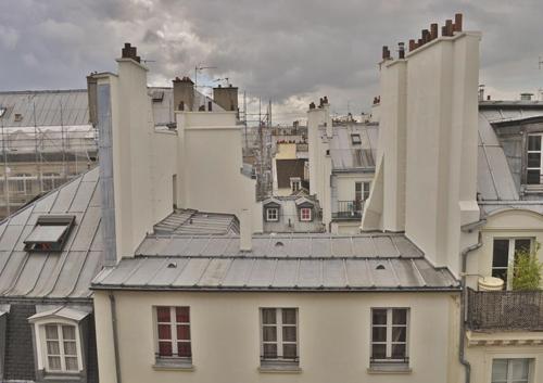 L'atelier: 150m² sur les toits de Paris