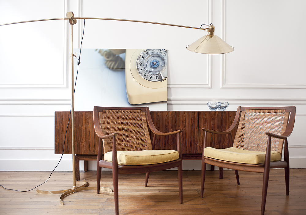Cantilevered German floor lamp together with cane-backed Hvidt & Nielsen chairs  Contemporary photograph of retro-telephone rests on mid-century Danish  credenza