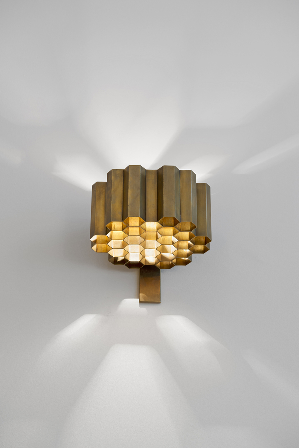 We sourced and restored a rare pair of Jules Wabbes honeycomb wall lights for a client project in Belgium
