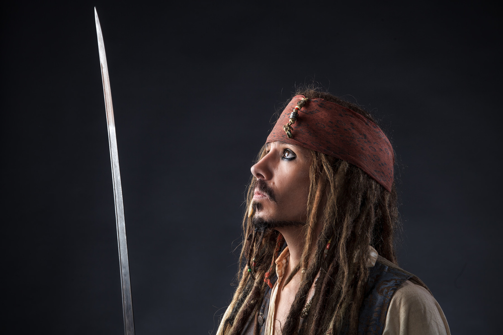 Jack Sparrow looking at his sword