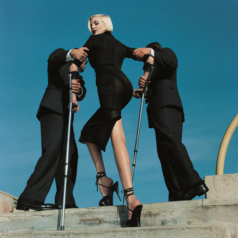 High & Mighty shoot, American Vogue  Artist: (model: Nadja Auermann) Dolce & Gabbana suit, Summer 1995 Date: February 1995  © Estate of Helmut Newton / Maconochie Photography