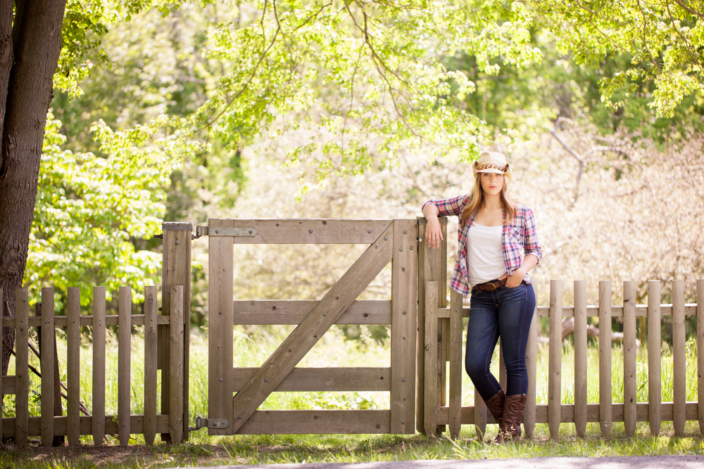 girl-leaning-on-fence-in-cowboy-hat-in-andover-mass