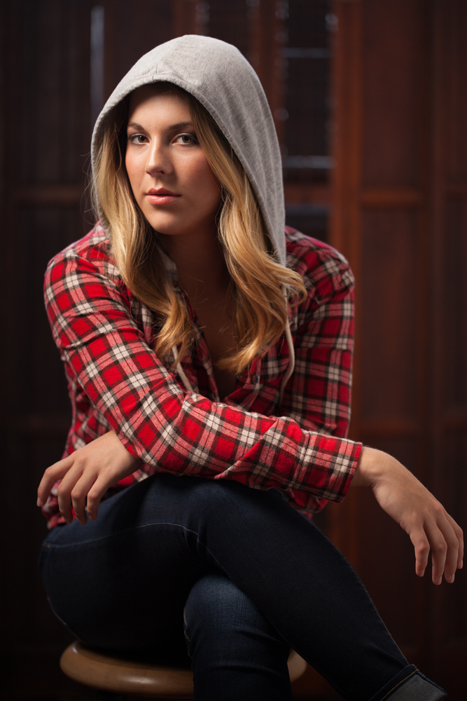 modern-senior-portrait-sessions-girl-in-hooded-plaid-shirt
