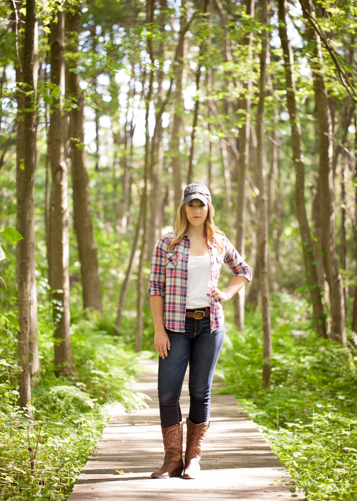 girl-poses-on-boardwalk-in-forrest.jpg