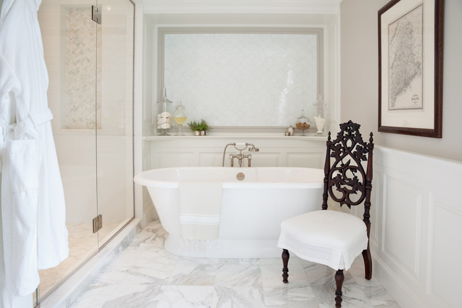 Modern white bathroom with custom monogrammed chair