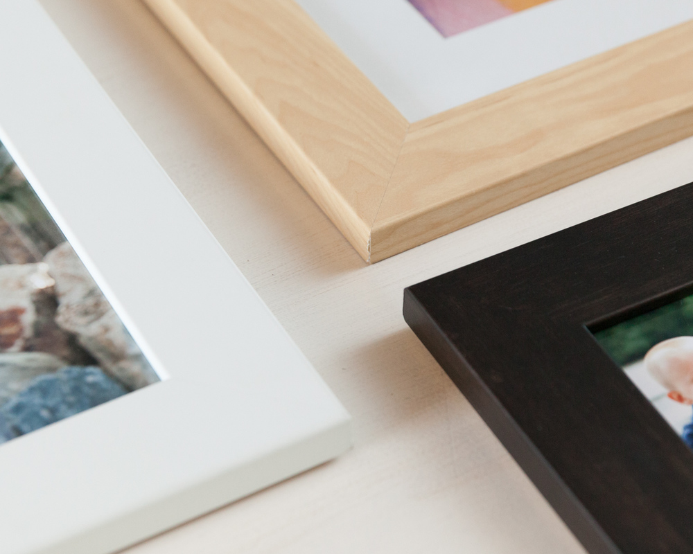 Standard wood frames come in white, light maple, and dark espresso