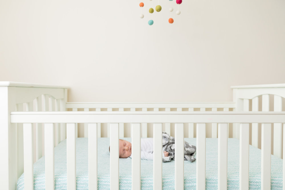 baby-in-crib-turquoise-nursery-mobile